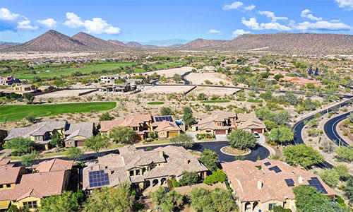 Aerial view of the homes, golf course, and surrounding mountains in Blackstone at Vistancia in Peoria, Arizona