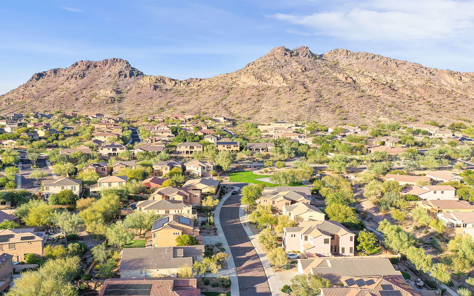 Aerial view of homes and mountains in WestWing Mountain in Peoria, Arizona