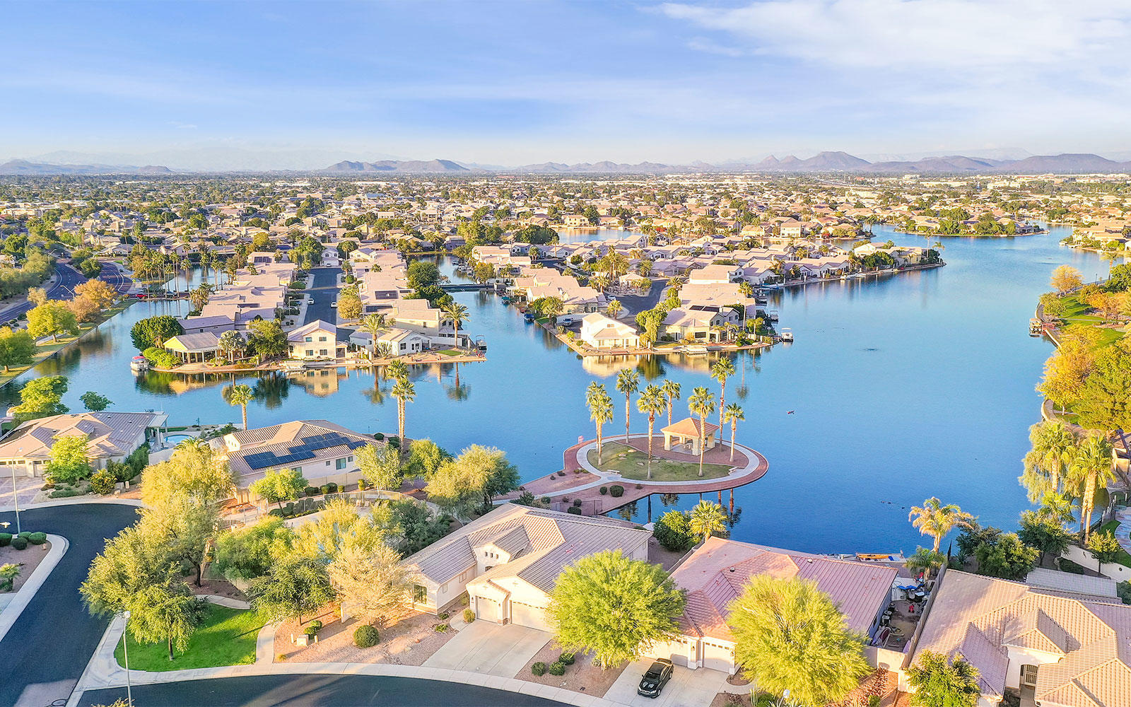 Aerial view of the lake and many waterfront homes in Desert Harbor in Peoria, Arizona